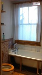 Before photo - the decor was quite dated and the window over the bath meant showering was impossible