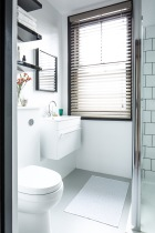 The bath was removed and a shower installed instead with a light and contemporary monochrome scheme