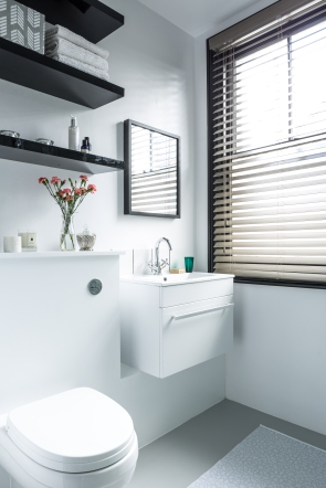 The basin was moved next to the window to make space for the shower and improves the amount of natural light around the mirror