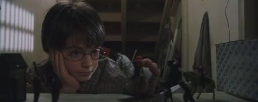 Harry_Potter_in_the_cupboard_under_the_stairs