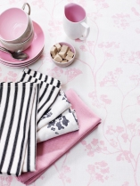 Ian Mankin Tablecloth in Kew Baltic Pink £39.50 per metre, napkins in Campbell Union Pink £39.50 per metre, Campbell Union Black £39.50 per metre and Black Ticking £24.50 per metre