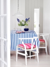 Ian Mankin: Tablecloth in Norfolk Stripe Indigo £24.50 per metre, Seat Covers in Oxford Stripe Peony £29.50 per metre, Napkins in Candy Stripe Peony and Indigo £19.50