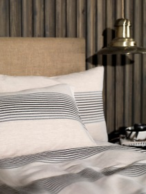 Black and natural linen bedding, prices starting at £12.00 from The Secret Linen Store