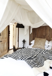 Image courtesy of Rock Ribbons featuring the black and cream Moroccan wool blanket with black pom poms