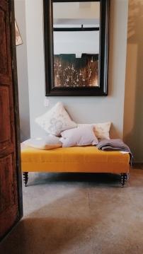 The Arthur footstool upholstered in Isla Finch cotton velvet