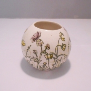 Ball vase, £20.00 by husband and wife team Adrian and Jennifer Bell. Each is unique and hand painted in their distinctive style.