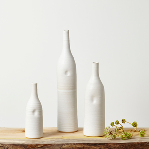 Elegant white ceramic bottles by Tone von Krogh. Inspired by Norway, the soft shapes emulate a snow covered landscape.