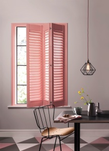 Coral Blush tracked wooden window shutters from Clement Browne