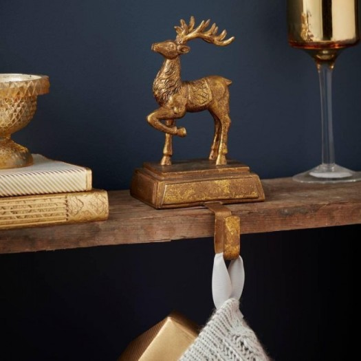 The Contemporary Home gold reindeer stocking hanger